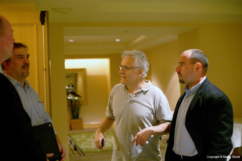 Organizer Ray Rogers of Corporate Campaign (center) talks with IBEW union leaders (names to come) after the DirectTv annual meeting at the Hilton hotel on 6th ave. in Manhattan.
