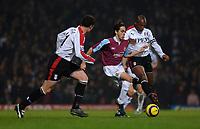 Photo: Daniel Hambury.<br />West Ham United v Fulham. The Barclays Premiership. 23/01/2006.<br />West Ham's Yossi Benayoun trys to get between Fulham's Wayne Bridge (L) and Luis Boa Morte.