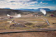 A power plant produces geothermal energy at Krafla, Iceland. The power plant turns heat from below the earth's crust into 60 megawatts of electricity. The Krafla area is very volcanic. The Krafla volcano erupted nine times between 1975 and 1984 and very high temperatures are found 3 to 5 kilometers (2 to 3 miles) of the earth's surface.