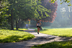 © Licensed to London News Pictures. 07/09/2021. London, UK. A runner enjoys a warm misty morning in Chestnuts Park, north London as the mini heatwave continues in London. According to the Met office, temperatures over 28 degree Celsius are forecast today in London and the South East of England. Photo credit: Dinendra Haria/LNP