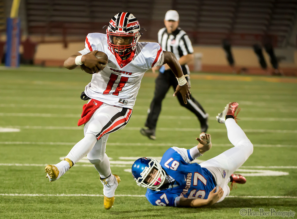 Cordova Lancers Xavier Johnson (11), runs with the ball during the first quarter of the Sac-Joaquin Section Division I football playoff game between the Christian Brothers Falcons and Cordova Lancers at Huges Stadium,  Friday Nov 11, 2016.<br /> photo by Brian Baer
