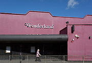 An elderly lady walks past Wonderland, a former nightclub in Sutton, south London, on 2nd October 2019, in Sutton, London, England.