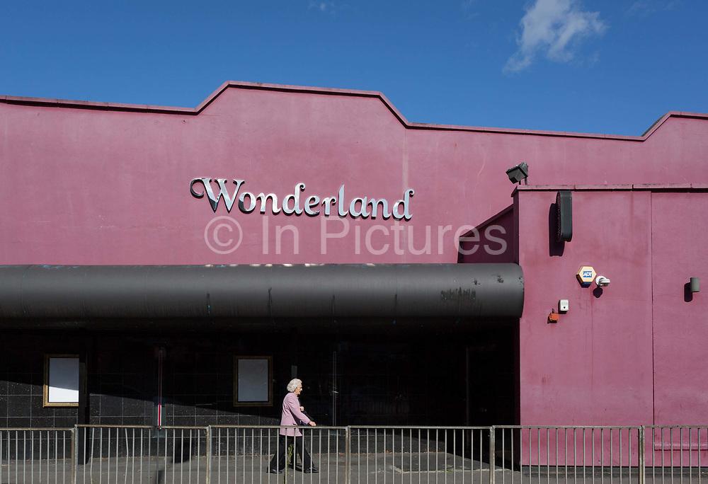 An elderly lady walks past Wonderland, a former nightclub in Sutton, south London, on 2nd October 2019, in Sutton, London, England.
