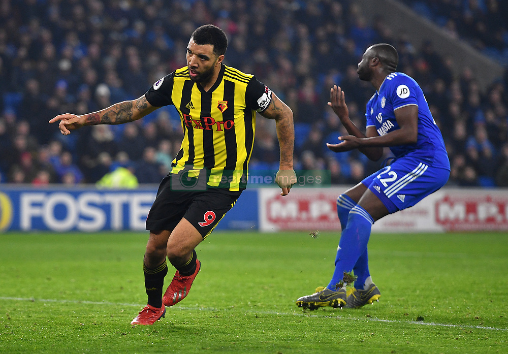 Watford's Troy Deeney (left) celebrates scoring his side's fourth goal of the game during the Premier League match at the Cardiff City Stadium.