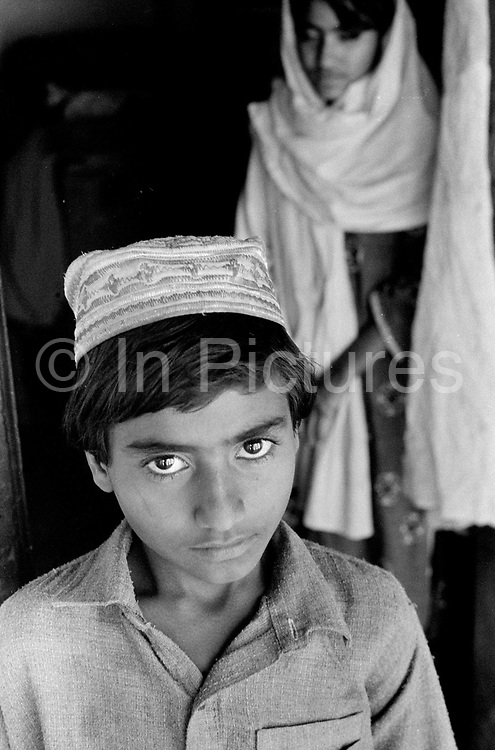 An Ahmadiya boy, Rabwah, Pakistan...Also known as Qadiani's The Ahmadiyyas are the followers of Hazrat Mirza Ghulam Ahmad Qadiani (1835-1908). According to his followers, he was the  founder of the Ahmadiyya Muslim Jama'at and The Promised Messiah and Imam Mahdi. The Ahmadiyya (Qadiani) movement in Islam is a religious organisation with more than 30 million members worldwide. Ahmadiyyas are now banned from calling themselves Muslim in Pakistan and suffer terrible discrimination under anti-blasphemy laws and are regularly murdered for their faith.