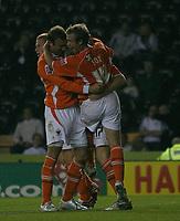 Photo: Steve Bond.<br />Derby County v Blackpool. Carling Cup. 28/08/2007. Kaspars Gorkss (obscured) & David Fox celebrate