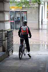 Man wearing a safety helmet riding his bike,