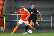 Blackpool forward Keshi Anderson (8) and Lincoln City forward Tom Hopper (9) during the EFL Sky Bet League 1 match between Blackpool and Lincoln City at Bloomfield Road, Blackpool, England on 3 October 2020.