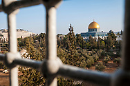 View of the Dome of the Rock through a window in Jerusalem's Muslim Quarter.