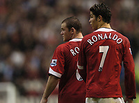 Fotball<br /> Premier League England<br /> Foto: BPI/Digitalsport<br /> NORWAY ONLY<br /> <br /> 24.10.2004<br /> Manchester United v Arsenal<br /> <br /> Wayne Rooney and Christiano Ronaldo