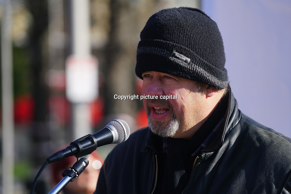 Speakers Tony Philips is a firefighter at Occupy E17 Market Square demand for affordable homes + no land grab against greedy housing development to build a tower block it cost three time of  minimum wages to lives there. Protestors demand affordable housing and rent control of greedy landlord on 24 Feb 2018 in Walthamstow square, London, UK.