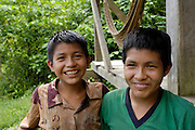 Ecuador, May 9 2010: Two of Chino's sons at Huaorani EcoLodge's campsite. Copyright 2010 Peter Horrell