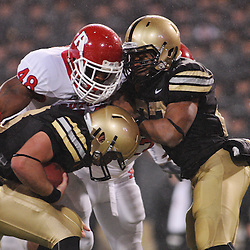 Oct 23, 2009; West Point, N.Y., USA; Rutgers defensive tackle Blair Bines (48) sacks Army quarterback Trent Steelman (8) during Rutgers' 27 - 10 victory over Army at Michie Stadium.