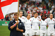 5th September 2010, Twickenham Stoop, London, England: England captain Catherine Spencer (left in white) leads her team preparing for the national anthem before the IRB Women's Rugby World Cup final between England and New Zealand Black Ferns (Photo by Andrew Tobin www.slikimages.com)