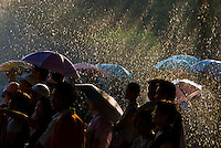 © Wenata Babkowski. All rights reserved.<br /> <br /> A sprinkling of rain sprays down on a crowd watching a performance in Shenzhen, China as rays of sun shimmer through the drizzle. One of the 50 winning images selected for the Digital Photographer of the Year 2007 Competition.