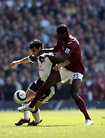 Photo: Olly Greenwood.<br />Arsenal v Tottenham Hotspur. The Barclays Premiership. 22/04/2006. Spurs' Paul Stalteri holds off Arsenal's Emmanuel Adebayor.