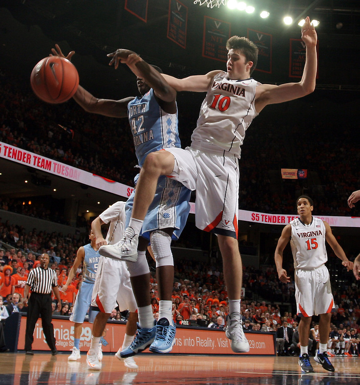 Virginia forward/center Mike Tobey (10) fights for the rebound with North Carolina forward Joel James (42) during an NCAA basketball game against Virginia Monday Jan. 20, 2014 in Charlottesville, VA. Virginia defeated North Carolina 76-61.