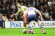 Manchester City midfielder Bernardo Silva tackles Preston North End defender Joe Rafferty during the EFL Cup match between Preston North End and Manchester City at Deepdale, Preston, England on 24 September 2019.