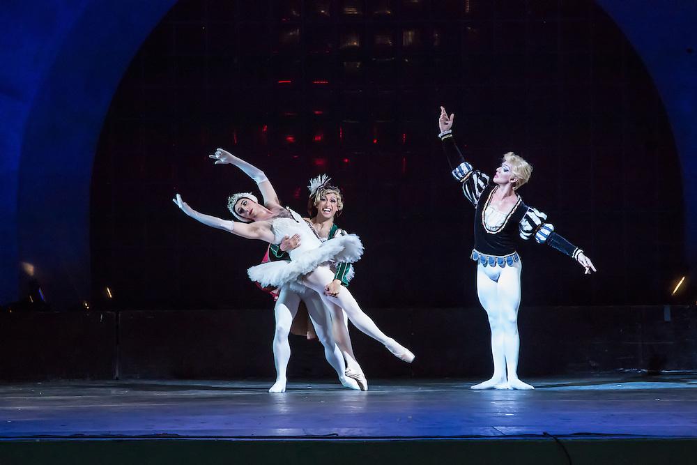 Siegfreid's friend Benno von Sommerstern and Odette dance as Siegfried looks on. Les Ballets Trockadero de Monte Carlo was founded in the 1970s.