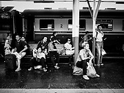 "11 APRIL 2017 - BANGKOK, THAILAND:  Holiday travelers wait for their train during the Songkran travel period at Hua Lamphong train station in Bangkok. Songkran is the traditional Thai Lunar New Year. It is celebrated, under different names, in Thailand, Myanmar, Laos, Cambodia and some parts of Vietnam and China. In most places the holiday is marked by water throwing and water fights and it is sometimes called the ""water festival."" This year's Songkran celebration in Thailand will be more subdued than usual because Thais are still mourning the October 2016 death of their revered Late King, Bhumibol Adulyadej. Songkran is officially a three day holiday, April 13-15, but is frequently celebrated for a full week. Thais start traveling back to their home provinces over the weekend; busses and trains going out of town have been packed.    PHOTO BY JACK KURTZ"
