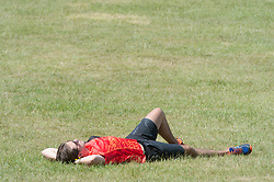 ©Licensed to London News Pictures 22/06/2020<br /> Greenwich, UK. A man sunbathing. A warm sunny day in Greenwich park, Greenwich, London. The UK to enjoy hot heatwave weather this week with temperatures set to bring the hottest day of the year so far. Photo credit: Grant Falvey/LNP