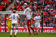AFC Flyde forward Alex Reid (30) Leyton Orient defender Josh Coulson (6) clash in the air during the FA Trophy final match between AFC Flyde and Leyton Orient at Wembley Stadium on 19 May 2019.