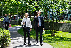 © Licensed to London News Pictures. 26/05/2016. London, UK. Finance workers enjoying sunshine and warm weather on their lunch breaks in Jubilee Park in Canary Wharf, London onThursday, 26 May 2016. Photo credit: Tolga Akmen/LNP