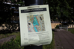 London, UK. 14th August, 2021. A planning application notice is pictured in communal space at Bells Gardens in Peckham. Southwark Council proposes to build 97 new homes (a mix of social and private housing), a reprovisioned community facility and a multi-use games area at Bells Gardens, a well-used community park serving the 545-home Bells Gardens estate. Southwark ranks fifth-worst in London and eighth-worst in the UK for easy access to green space.