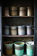 Empty pots at Babu Shahi Bawarchi, New Delhi, India<br /> The famous but modest takeaway housed in the grounds of a shrine is famous for its biryani and whose owners ancestors served as chief cooks under the Moghul Emperor, Shah Jahan