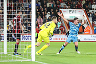 Forest Green Rovers Matty Stevens(9) heads at goal and saved on the line by Bournemouth's Andrew Surman(6) during the EFL Cup match between Bournemouth and Forest Green Rovers at the Vitality Stadium, Bournemouth, England on 28 August 2019.