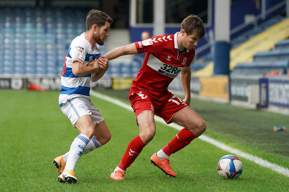 Middlesbrough's Paddy McNair battles for possession with Queens Park Rangers' Paul Smyth<br /> <br /> Photographer Stephanie Meek/CameraSport<br /> <br /> The EFL Sky Bet Championship - Queens Park Rangers v Middlesbrough - Saturday 26th September 2020 - Loftus Road - London <br /> <br /> World Copyright © 2020 CameraSport. All rights reserved. 43 Linden Ave. Countesthorpe. Leicester. England. LE8 5PG - Tel: +44 (0) 116 277 4147 - admin@camerasport.com - www.camerasport.com