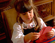Girl age 5 playing cards.  WesternSprings  Illinois USA