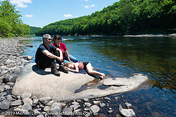 Paul Cox with his wife Anne and daughter Dylan on the banks of the Delaware River in Port Jervis, NY. USA. Monday June 11, 2018. Photography ©2018 Michael Lichter.
