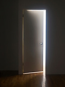 Mysterious doorway with light in the room on the other side