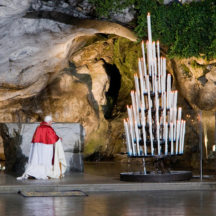 """France - Lourdes -  13 September 2008 -  Pope Benedict XVI pray in front of the Holy virgin at the place where Bernadette Soubirous have seen the Holy Virgin. This place his called """" La Grotte """", Saturday, Sept. 13, 2008. The pope closed a visit to the Lourdes shrine reputed for its healing powers. His four-day trip to Paris and Lourdes was his first to France since his election as pontiff in 2005. © Patrick Mascart.. ..----..cf: Religion / faith / belief / catholic / Christianity / piligrimage / place of pilgrimage / Jesus-Christ /"""