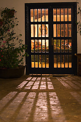 South America, Ecuador, Imbabura Province, Zuleta, doors of hacienda  and shadows