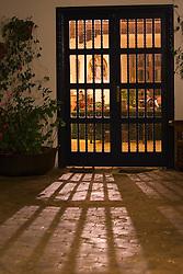 South America, Ecuador, Imbabura Province, Zuleta, doors of hacienda  and shadows