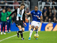 Football - 2019 / 2020 Premier League - Newcastle United vs. Everton<br /> <br /> Florian Lejeune of Newcastle United vies with Djibril Sidibe of Everton, at St James' Park Stadium.<br /> <br /> COLORSPORT/BRUCE WHITE