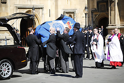 © Licensed to London News Pictures. 09/04/2017. London, UK. The coffin of PC Keith Palmer arrives at Chapel of St Mary Undercroft within the Palace of Westminster, ahead of his funeral tomorrow (Mon). PC Palmer was killed in a terror attack when Khalid Masood drove a car at pedestrians over Westminster Bridge and then attempted to enter Parliament with a knife. Photo credit: Tolga Akmen/LNP