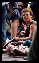 1st Sept, 2005. Mass evacuation of New Orleans begins. People collapse in the heat as massed crowds attempt to board busses out of New Orleans.