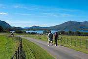 Walkers take a stroll by Lough Lein, Killarney's Lower Lake on a trip around the Muckross Demesne in Killarney National Park..Picture by Don MacMonagle