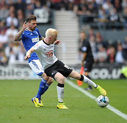 Derby County's Will Hughes attempts to keep the ball in play under pressure from Ipswich Town's Paul Anderson - Photo mandatory by-line: Dougie Allward/JMP - Mobile: 07966 386802 30/08/2014 - SPORT - FOOTBALL - Derby - iPro Stadium - Derby County v Ipswich Town - Sky Bet Championship