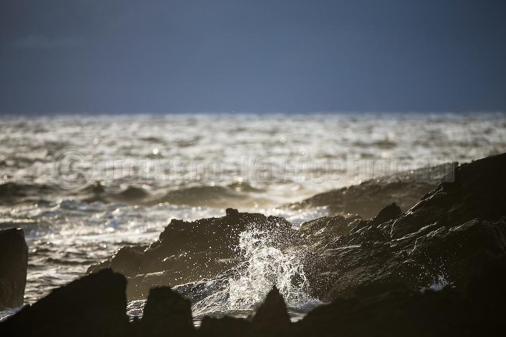 Cliffs with sea spray, and a little glimps of sunshine   Svaberg med sjøsprøyt, og et lite glimt av solen.