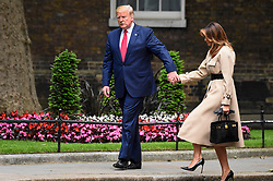 © Licensed to London News Pictures. 04/06/2019. LONDON, UK.  US President Donald Trump and Melania Trump arrive in Downing Street to meet outgoing Prime Minister Theresa May for talks, on day two of his three day State Visit to the UK.  Photo credit: Stephen Chung/LNP