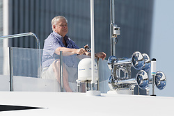© Licensed to London News Pictures. 15/07/2018. London, UK.  An unidentified man, who may be owner, James Dicke onboard superyacht Reef Chief. Superyacht, Reef Chief, owned by the CEO of Crown Equipment Corporation, James Dicke visits London on the River Thames.  The 161ft custom built yacht sleeps up to 11 guests in 5 rooms, including a master suite, 3 double cabins, 1 twin cabin and 1 pullman bed,  plus carries up to 9 crew and boasts various luxuries including a Deck Jacuzzi. Reef Chief is one of an increasing number of superyachts to visit London this year. Photo credit: Vickie Flores/LNP