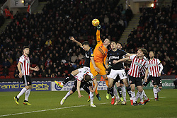 February 13, 2019 - Sheffield, South Yorkshire, United Kingdom - SHEFFIELD, UK 13TH FEBRUARY  Dean Henderson of Sheffield United punches clearf under pressure from Middlesbrough's Daniel Ayala during the Sky Bet Championship match between Sheffield United and Middlesbrough at Bramall Lane, Sheffield on Wednesday 13th February 2019. (Credit: Mark Fletcher | MI News) (Credit Image: © Mi News/NurPhoto via ZUMA Press)