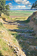 Part of the Schliemann Trench excavated from 1871 with remains of the original walls and Bronze age house walls of Troy from the Early Troia I Period, c. 2920 B.C. Troy archaeological site, A UNESCO World Heritage Site, Turkey