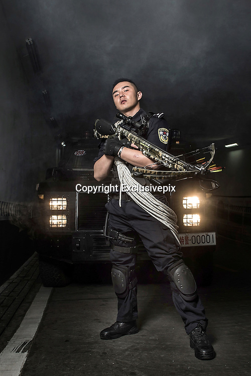 CHENGDU, SICHUAN - JULY 02: (CHINA OUT) <br /> <br /> Eye-Catching Posters Are Used For Police Recruitment In Chengdu<br /> <br /> Guns, high kicks and crossbows. Posters for a new Hong Kong action flick? No, these are recruitment posters for Chinese police force<br /> <br /> At first look anyone would think these were a series of adverts for a high-octane police action blockbuster.<br /> But these posters featuring officers carrying crossbows and performing high kicks are in fact part of a recruitment drive for the Chengdu police force in south west China.<br /> The force released the posters, each showcasing different qualities required by applicants including 'bravery' and 'toughness', on their official Weibo page.<br /> <br /> Chengdu Police are looking to recruit for a total of 359 positions within the force, including 100 posts for special armed forces and SWAT teams, Shanghaiist has reported.<br /> The recruitment posters have attracted interest from online viewers, The Telegraph has reported, including one Weibo user who wrote: 'My future boyfriend will be like this.'<br /> <br /> In May, China announced a nationwide, year-long 'anti-terror operation', days after announcing a similar crackdown targeting the troubled Xinjiang region, in the north west of the country, following an attack which killed dozens.<br /> Security forces were ordered to prevent militants moving beyond the region in China's far west, which has a large Muslim Uighur minority and where five suicide bombers struck in the Xinjiang capital of Urumqi.<br /> <br /> 'Police are urged to stop terrorists from striking again and prevent terrorists and religious extremists from spreading from Xinjiang to the rest of the country,' said the official Xinhua news agency, citing China's Ministry of Public Security.<br /> A similar campaign was launched in Xinjiang days earlier after the region's deadliest attack in years which state media reported had killed 31 people at a vegetable market.<br /> The a