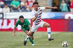 May 28, 2018 - Chester, PA, U.S. - CHESTER, PA - MAY 28: United States defender Antonee Robinson (17) battles with Bolivia forward Hector Ronaldo Sanchez (20) during the international friendly match between the United States and Bolivia at the Talen Energy Stadium on May 28, 2018 in Chester, Pennsylvania. (Photo by Robin Alam/Icon Sportswire) (Credit Image: © Robin Alam/Icon SMI via ZUMA Press)