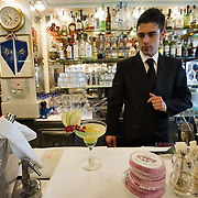 VENICE, ITALY - DECEMBER 02:  The head barman of the Caffe Lavena prepares a Cocktail on December 2, 2011 in Venice, Italy.The Venetian coffee houses have a  long standing history, established at the beginning of 1700 around St. Mark Square have been the centre of cultural meeting and innovations for centuries and served customers like Dickens, Goethe, Casanova and Lord Byron. San Marco is one of the six sestieri of Venice, lying in the heart of the city.